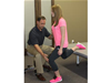 Troy Roehrs, PT working with Erin M. on lower extremity mechanics