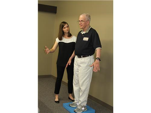 Mandy Rohrig, PT working on balance with Jerry P.
