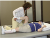 Tammy Roehrs, PT assisting with lower extremity range of motion with patient
