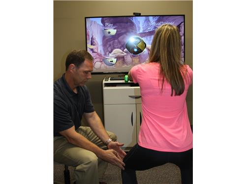 Troy Roehrs, PT using gaming technology during treatment