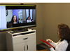Tammy Roehrs, PT on a teleconference with patient